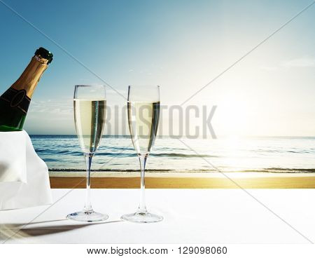 champaign Glasses and sunset on Seychelles beach