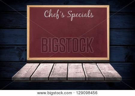 Composite image of chalkboard on a wooden shelf