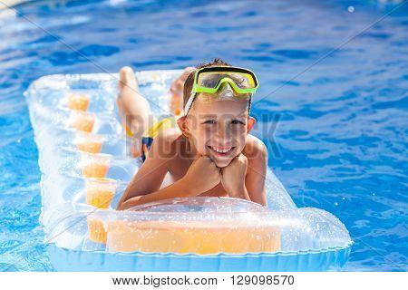 Casual boy having fun in swimming pool
