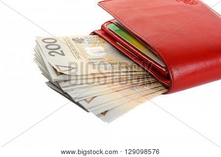 Wallet with polish zloty isolated on white.