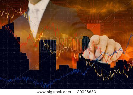 Smiling businessman in suit pointing against cityscape design