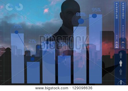businessman using a tablet and smiling at the camera against abstract cityscape