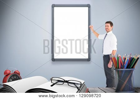 Businessman standing with his briefcase against a mirror