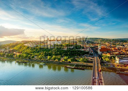 Bratislava aerial cityscape view on the old town with Saint Martin's cathedral, castle hill and Danube river on the sunset in Slovakia. Wide angle view with copy space ** Note: Soft Focus at 100%, best at smaller sizes
