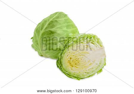 One whole head of young fresh white cabbage and one cabbage is cut in half on a light background