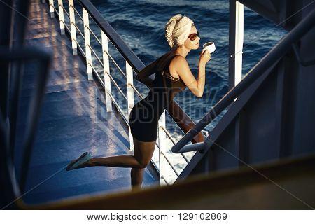 Beautiful blonde female drink coffee