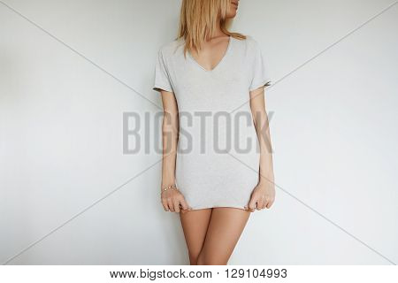 Advertising And T-shirt Design Concept: Cropped Portrait Of Attractive Young Female Model With Blond