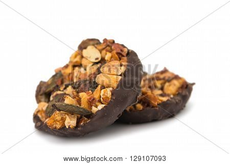 nutty dessert in chocolate on a white background