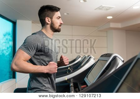 Fitness Man Running On Treadmill