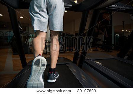 Close-up Man Feet On Treadmill
