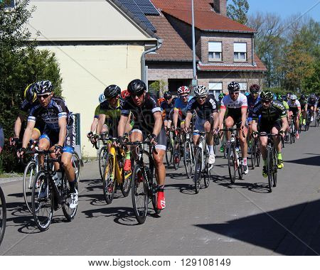 AALST, BELGIUM MAY 5 2016: Amateur riders from various cycle clubs compete in a bike race through the streets of Aalst, in East Flanders Belgium. Cycling is a very popular sport in Belgium.