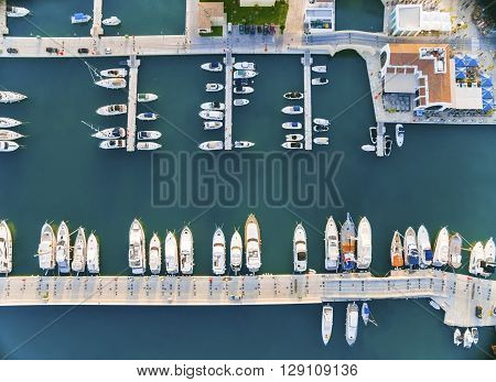 LIMASSOL, CYPRUS, 18 March, 2016: Aerial view of the beautiful Marina in Limassol city in Cyprus the boats lined up piers and commercial area from above. A very modern high end and newly developed space where yachts are moored and it's perfect for a water
