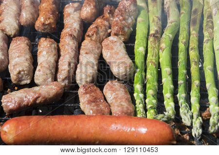 Cevapi famous Balkan dish sausage and asparagus on a grill. ** Note: Shallow depth of field