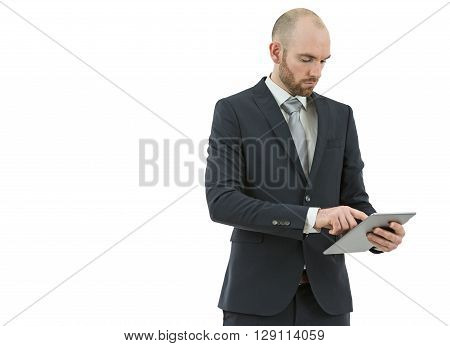 Caucasian business man working on a tablet computer. Isolated on white background.