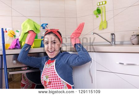 Excited Cleaning Lady In Kitchen