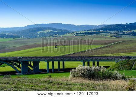 Spring landscape of Spis Slovakia with highway bridge