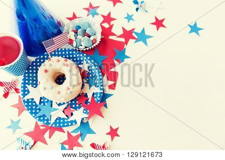 american independence day, celebration, patriotism and holidays concept - close up of glazed sweet donut with juice and candies in disposable tableware at 4th july party from top