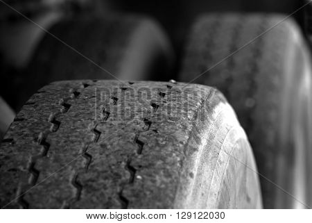 Detail shot of a large tire for truck or car transportation on road