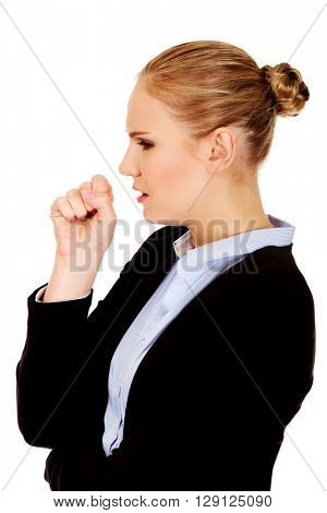 Young sick business woman coughing