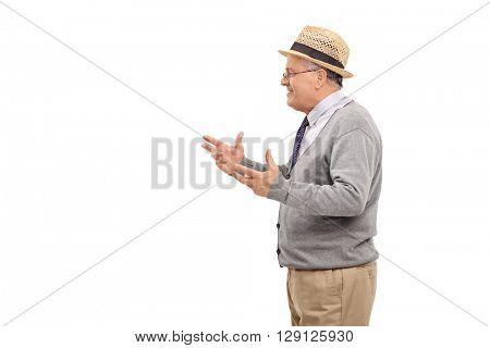 Studio shot of a senior gentleman explaining something isolated on white background