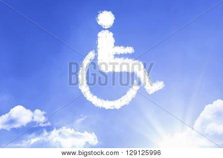 Wheelchair Symbol written a cloud with a blue sky