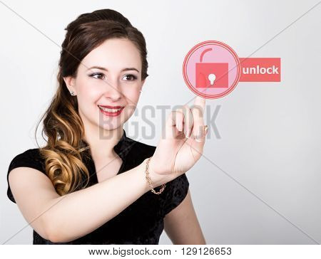 technology, internet and networking concept. beautiful woman in a black business shirt. woman presses unlock button on virtual screens.