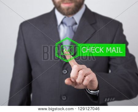 technology, internet and networking concept. man in a black business shirt. businessman presses check mail button on virtual screens.