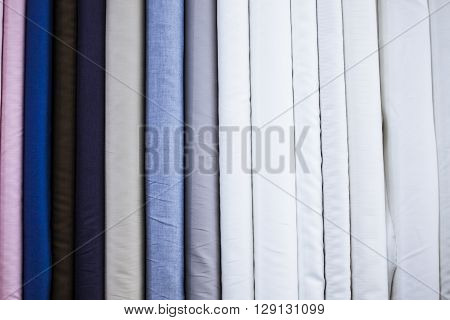 Many types of fine cloth at a bespoke tailor shop
