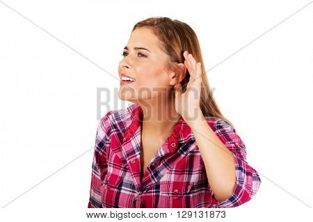 Young woman overhearing a conversation