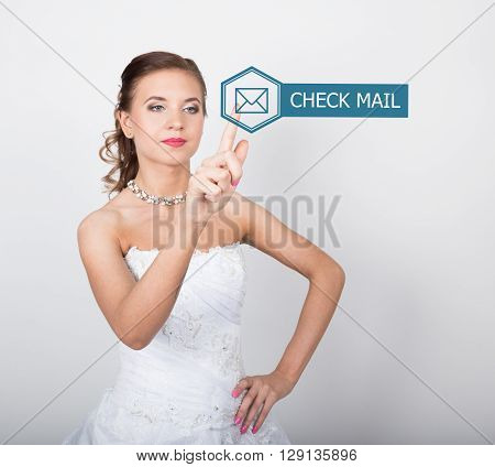 technology, internet and networking concept. Beautiful bride in fashion wedding dress. Bride presses check mail button on virtual screens