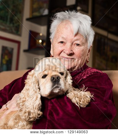 Old Woman With American Spanie