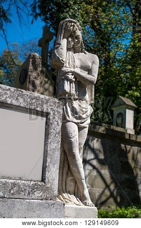 Old Statue On Grave