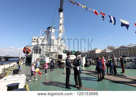 ST. PETERSBURG, RUSSIA - MAY 2, 2016: People at the icebreaker Mudyug during 3rd Icebreaker Festival. It's unique fest dedicated to icebreaker fleet