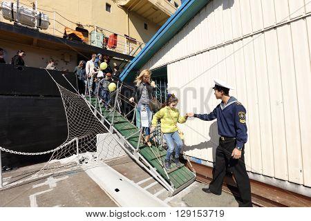 ST. PETERSBURG, RUSSIA - MAY 2, 2016: People at the oldest operating Russian icebreaker Ivan Krusenstern during 3rd Icebreaker Festival. It's unique fest dedicated to icebreaker fleet
