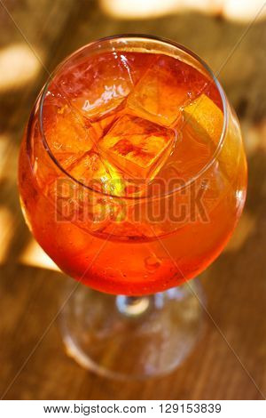 Aperol spritz cocktail in sunlights. Sparkling wine, champagne alcohol drink with ice cubes. Top view.