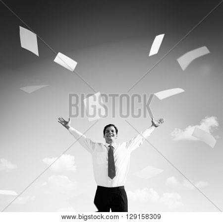 Business Man on the Field with his Arms Raised Throwing Paperworks poster