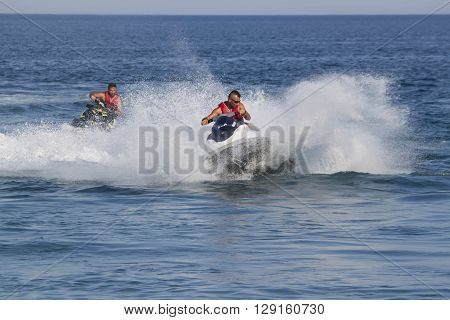 CAMYUVA KEMER TURKEY - JULY 16 2015: Unidentified Turkish men compete with each other on water scooters. Extreme water sports are increasingly popular on the beaches of Turkey