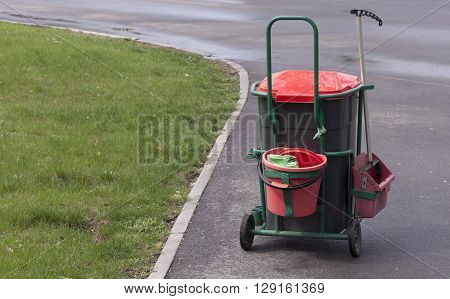 Trolley with supplies cleaner in the park