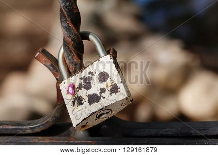 Vintage lock macro view. Security concept with closed silver padlock. soft focus