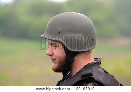 An unidentified person wears modern Ukrainian nazionalist battalion uniform . At May 7,2016 in Kiev, Ukraine
