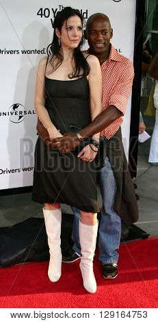 "Mary-Louise Parker and Romany Malco at the Los Angeles premiere of ""The 40 Year-Old Virgin"" held at the ArcLight Theatre in Hollywood, USA on August 11, 2005."