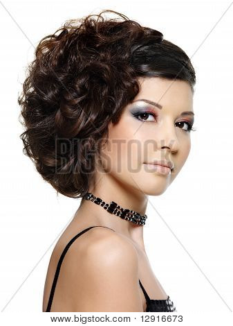 Young Beautiful Woman With Modern Hairstyle