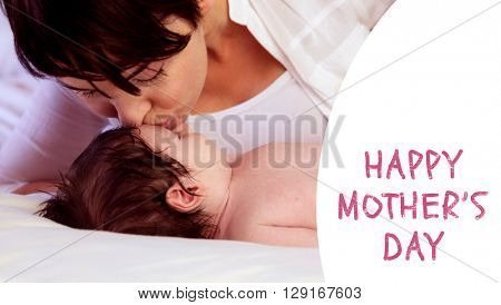 Mothers day greeting against a mother kissing her baby