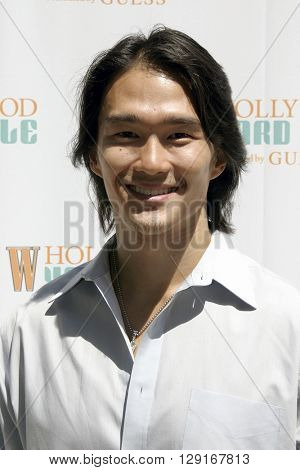 Karl Yune at the W Magazine Hollywood Yard Sale held at the W Mag in Los Angeles, USA on September 12, 2004.