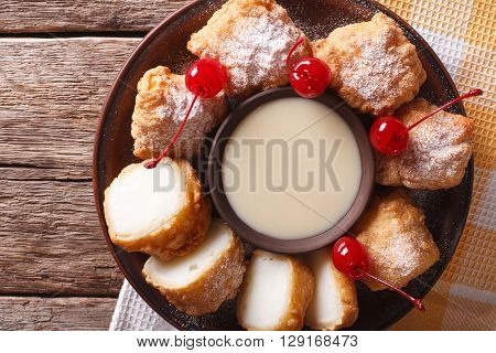 Dessert Leche Frita With Condensed Milk And Cherries Closeup. Horizontal Top View