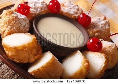 Leche Frita With Condensed Milk And Cherries Macro. Horizontal