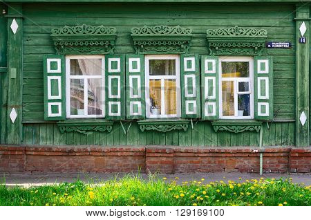 GOMEL BELARUS - MAY 1 2016: Fragment of wooden building of the 19th - early 20th centuries Paris Commune Street 14 Gomel Belarus