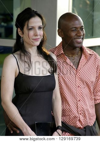 "Mary Louise Parker and Romany Malco at the Los Angeles premiere of ""The 40 Year Old Virgin"" held at the ArcLight Theatre in Hollywood, USA August 11, 2005."
