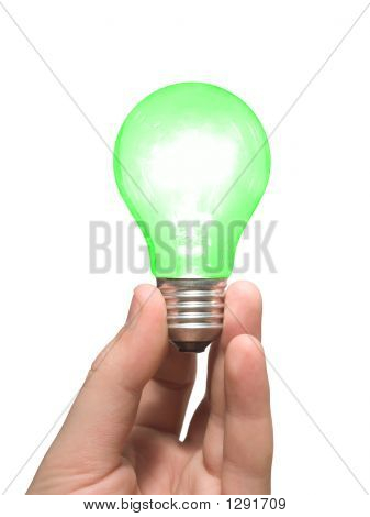 Green Light Bulb In Hand