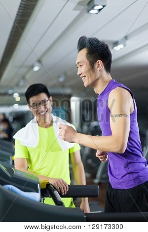 young asian people working out in modern gym